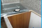 Hvordan installere koketoppen i benkeplaten